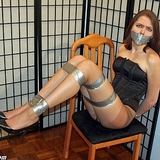 Lanie Stripped Down To Her Corset and Pantyhose and All Taped Up