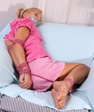 Foxy - Pretty in Pink - And In Tight Ropes. Who can resist the strong desire to reach through the screen and rescue our blonde cute-pigtails-in-her-hair damsel? Watch her struggle - she can't move ...
