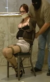 Angel Chair Bound. Tightly cinched to the chair with her sexy nipples poking out of her bra