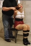 Poor Lydia - Ball gagged and a rope harnessed with her ankles,knees tied tightl. High Heel Boots and a mini ski