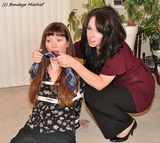 Security Training starring Celia Cyniade & Kitti Richards. Frisked, Gagged on Screen, Skirt with a Slit, Stockinged Feet, Roped Elbows, Cleave Gagged