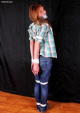 Tightly Bound Elbow and Tape Gag Struggle - Tape gagged, blue jeans, elbows tied