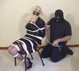 Chair Tied On Screen. Blonde, Chair Tied, High Heels, Silk Stockings, Garters, Breast Harness