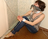 Cuff and Chain Struggle. Sexy strappy high heels, tight blue jeans, fashion blouse, cuffs, chains, cleave gag