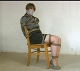 Elizabeth Andrews - Chair Tied in the Basement, tape gagged, chair tied, high heels