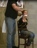 Tightly Chair Bound and Gagged To Shut Her Mouth. She struggles and gripes and gripes and gripes ... once he had enough he steps in, stuffs her mouth and gags her! From RopExpert.com ... did she reall