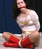 Frustrated Powergirl Balltied and Gagged