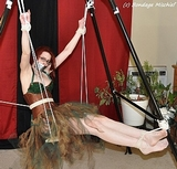 Swinging Bondage. Redhead, eye glasses, pantyhose