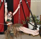 Swinging Bondage. Redhead, eye glasses, pantyhose
