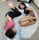 Two Beauties Hogtied Barefoot, Roped Together Struggle