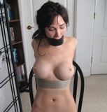 Midnight - Hot nanked babe, tightly bound, gagged and struggling. Visit DetectiveChronicles.com for more hot action like this for one low price!