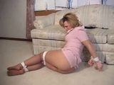 ong sexy legs covered in pantyhose and stiletto high heel pumps. Watch her go through her mail while massaging her silk clad legs. Did she hear something in the house? Probably just a mouse ...