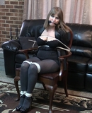 Becca The Damsel tied to the chair in business suit